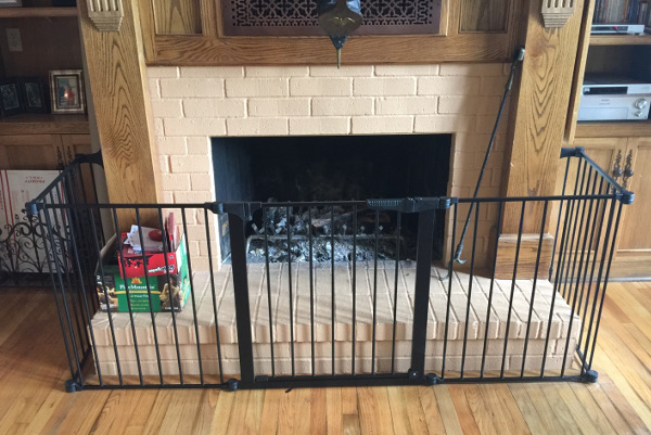 Child safety gate installed around a fireplace in Lake Charles Louisiana. Baby Safe gate will help prevent burns and bumps and bruises