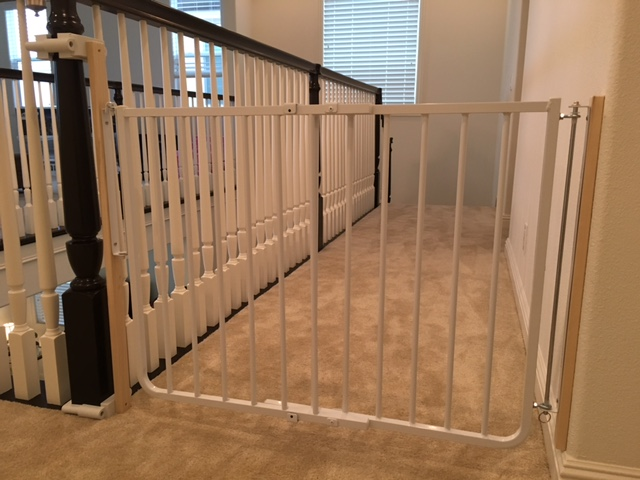 Baby gate placed by Baby Safe Homes at the top of the stairs