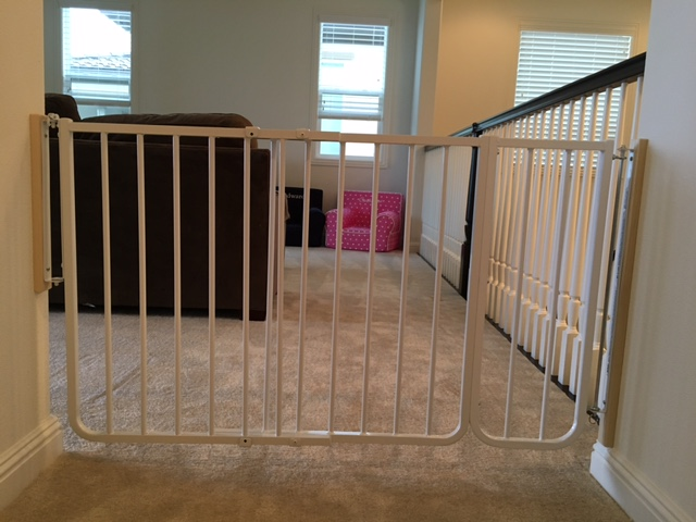 Baby proof baby gate placed at the entrance of the playroom by Baby Safe Homes