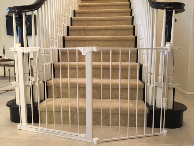 Custom sectional baby proof baby gate for extra wide opening at the bottom of the stairs placed by Baby Safe Homes