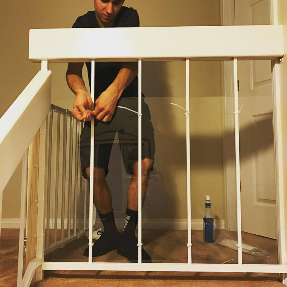 Baby safety installation on stair banister