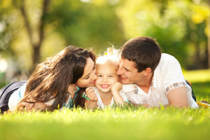 bigstock-Happy-mother-and-father-kissin-38884324