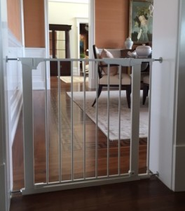 Tension gate for opening to formal dining room.