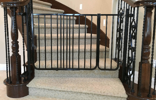 Custom Installation Of A Black Baby Safety Gate At The Bottom Stairs In Coto De Caza Toddler Was Installed With Stair Banister Clamps