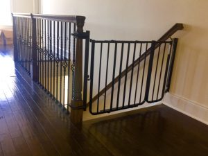Baby gate installed on an oversized staircase in New Jersey