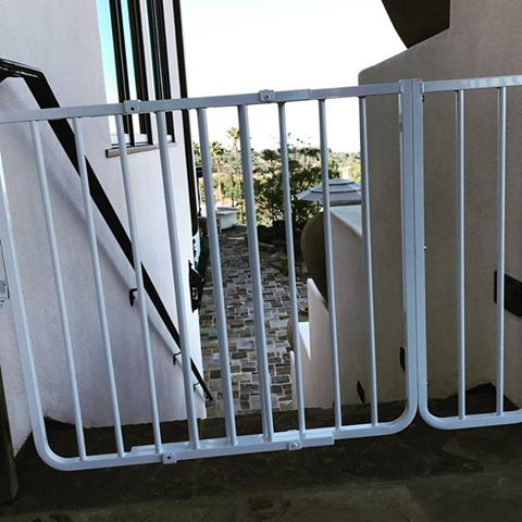 Outdoor safety baby gate at top of balcony stairs. by Baby Safe Homes