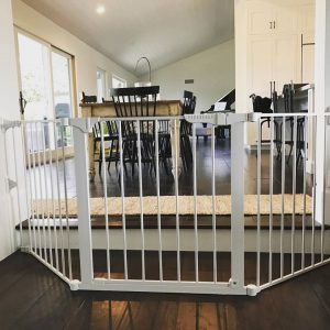 Large sectional child safety gate to create a child safe play area