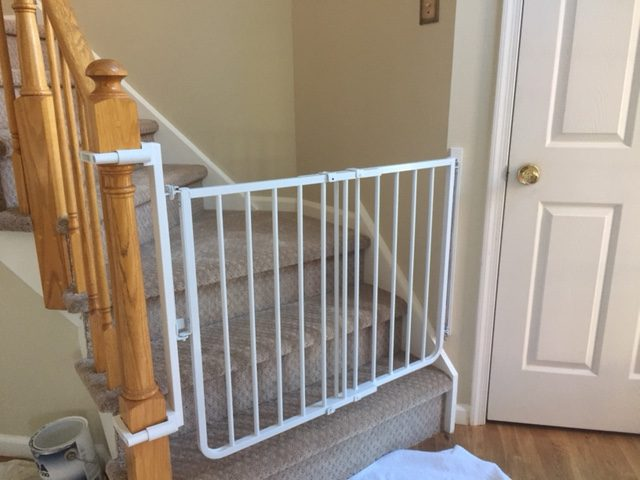 Baby gate with no hole clamps installed by baby safe homes in new jersey