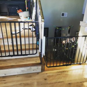 Child safety gate for top and bottom of stairs using a special wrought iron no holes clamping system.