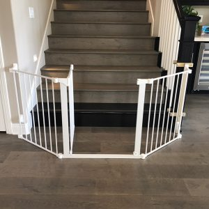 extrawide baby gate at bottom of stairs